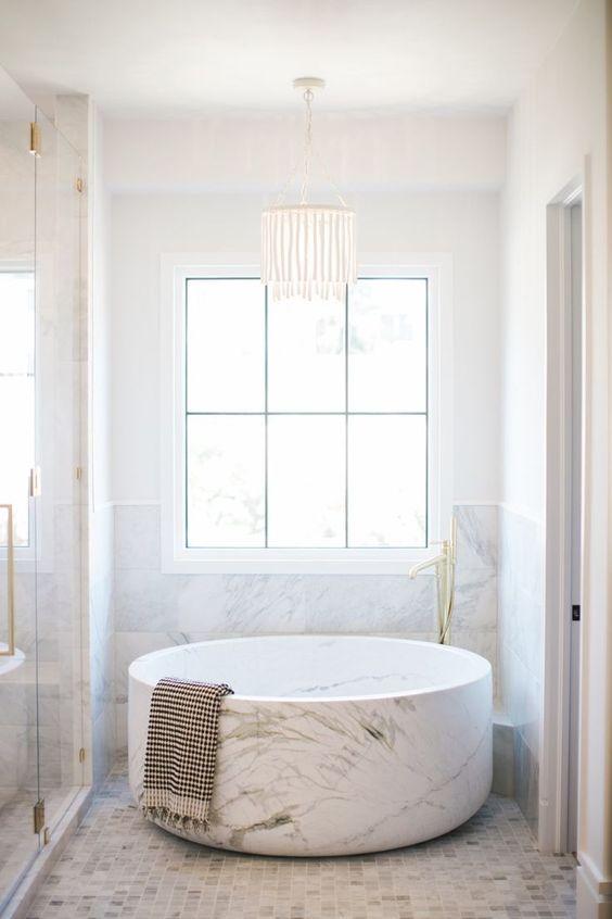 bathroom, white wall, white marble wall, white marble round tub, white floor, white chandelier