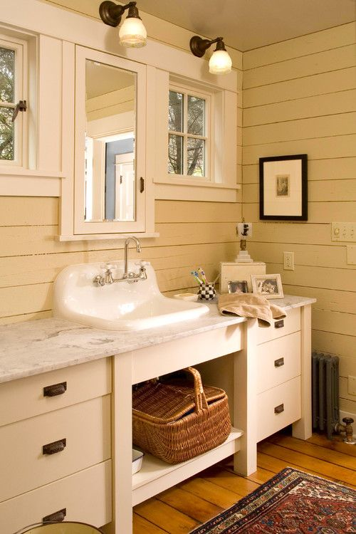 bathroom, white wooden planks, wooden floor planks, white cabinet, white marble top, white sink, patterned rug