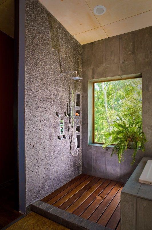 bathroom, wooden bathroom floor, grey wall, glass window
