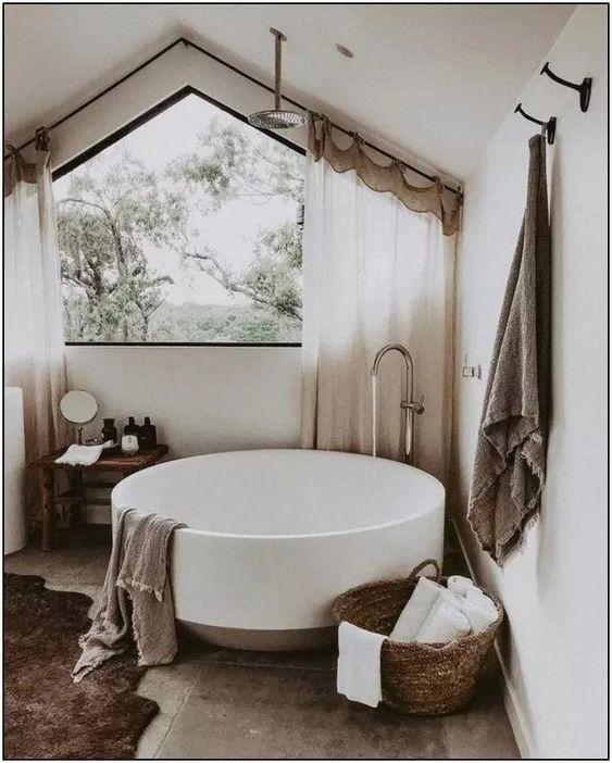 bathroom, wooden floor, white wall, white round tub, white curtain,  triangle window,