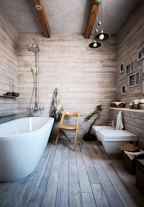 bathroom, wooden floor, wooden wall, grey ceiling with wooden beams, pendant, white toilet, white sink, white tub, white floating shelves