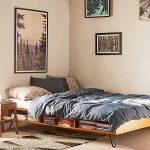 Bed Platform, Metal Legs, Shelves, Brown Rug, Cream Wall, Wooden Stools