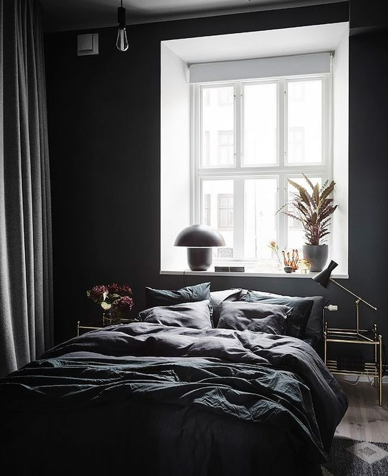 bedroom, black wall, wooden floor, black bedding, white window sill