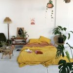 Bedroom, White Floor, White Wall, Yellow Bedding, Rattan Chair, Rattan Coffee Table, Black Chair, Wooden Side Table