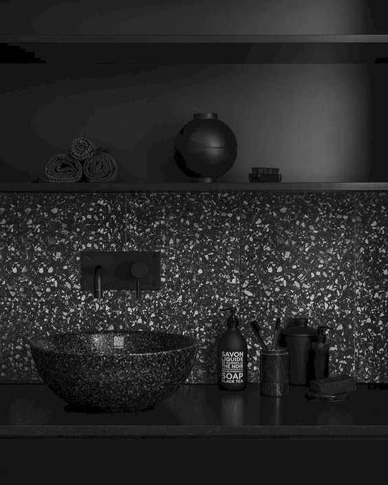 black terrazzo marble backsplash, black floating shelves, black counter top, black terrazzo marble bowl sink