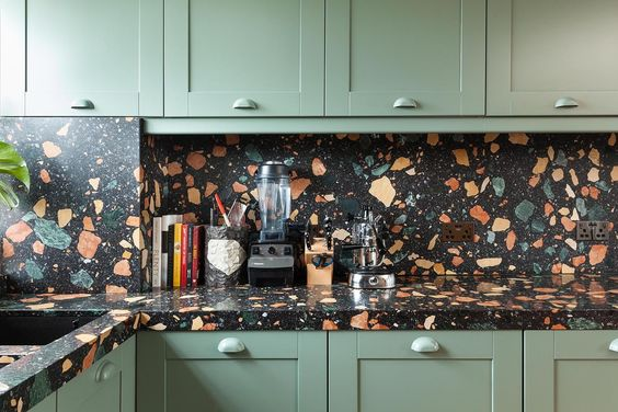 black terrazzo marble with colorful flocks, mint green cabinet