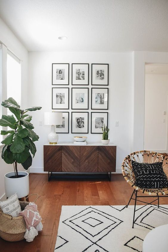 chevron patterned cabinet in the hallway, wooden floor, white rug, rattan chairs