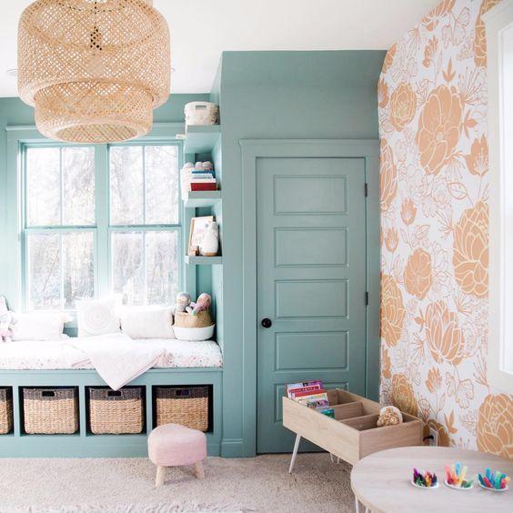 children's bedroom, brown rug, green shelves, green framed window, green cupboard, rattan pendant, orange flower pattern wall