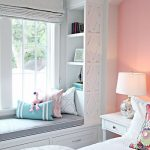 Children's Bedroom, White Bedding, Pink Accent Wall, White Side Table, White Table Lamp, White Built In Bench With Drawer, Built In Shelves