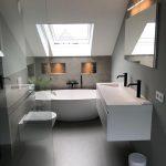 Concrete Floor, Concrete Wall, White Floating Sink, White Floating Toilet, White Tub, Ceiling Window, Mirror