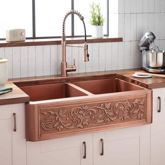 copper carved kitchen sink, white bottom cabinet, white vertical subway backsplash tiles