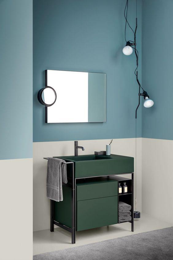 cream wall, soft navy wall, dark green vanity, grey floor