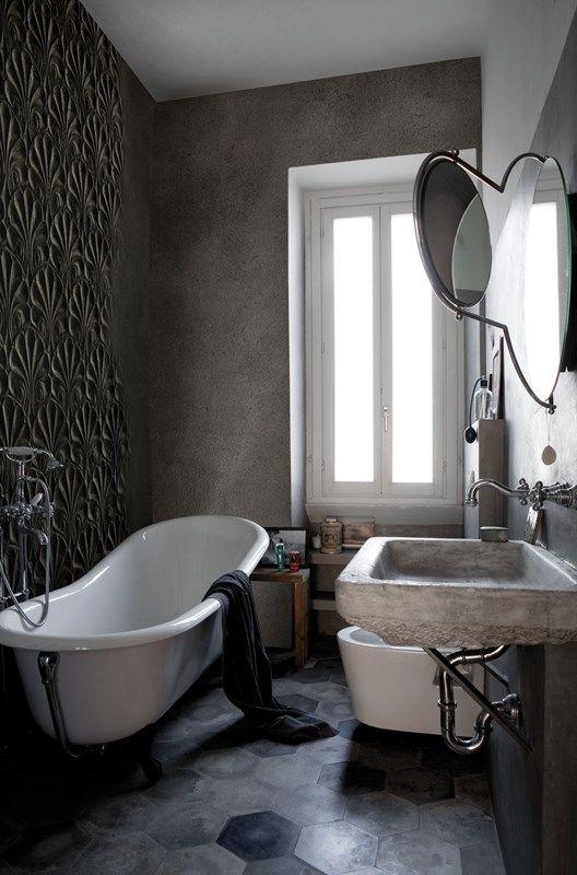 dark grey wall, detailed wall, floating concrete sink, grey hexagonal floor tiles, white framed window