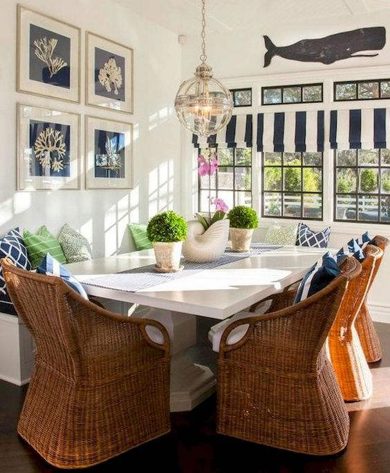 dining nook, wooden floor, white wall, rattan chairs, white table, white bench, glass globe pendant, white blue striped curtain