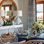 Dining Room, Brown Floor Tiles, White Wall, White Console Table, White Table Lamp, Round Mirror, Blue Patterned Curtain, White Chair With White Patter On The Back And Blue Cushion