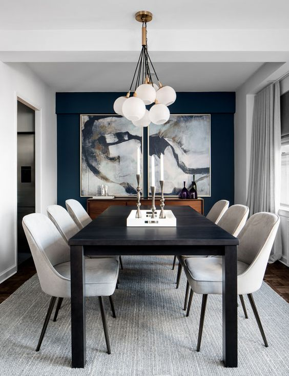 dining room, dark wooden floor, white wall, white chairs, black table, white balls chandelier, blue accent wall, grey rug, grey curtain