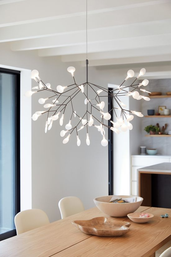 dining room, white wall, white leaves pendant, wooden table, white chair