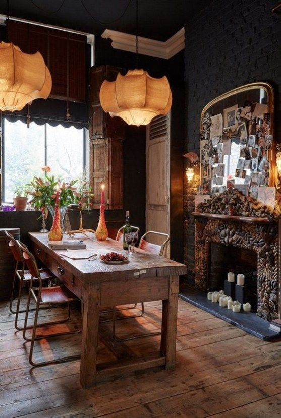 dining room, wooden floor, dark wall, brown pendant, wooden table, red chairs, fire place