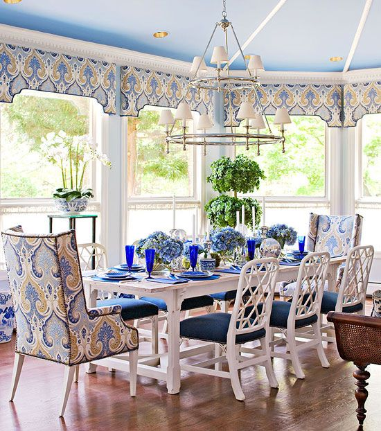 dining room, wooden floor, large glass windows, white wooden table, white wooden chairs, blue pattern cushion, blue cushion, bleu pattern curtain