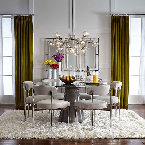 dining room, wooden floor, white wall, glass chandelier, white chairs, glass round table