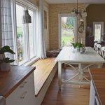 Dining Room, Wooden Table, Wooden Window Seat, White Wooden Table, Chandelier, White Cabinet, Exposed Brick