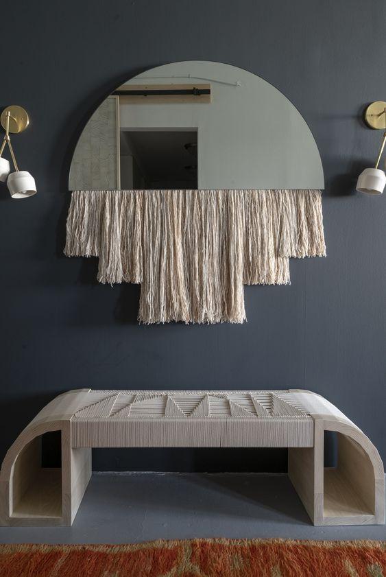 entrance, bleu floor, dark blue wall, fringe, mirror, sconces, rattan bench