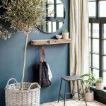Entrance, Brick Floor, Blue Wall, Wooden Floating Shelf, Round Mirror, Stool, Glass Windows, Cream Curtain, Rattan Pot