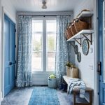 Entrance, Grey Floor, Blue Long Rug, White Shiplap, Blue Door, White Floating Shelves, Wooden Bench With White Cushion, Blue Curtain, Star Pendant