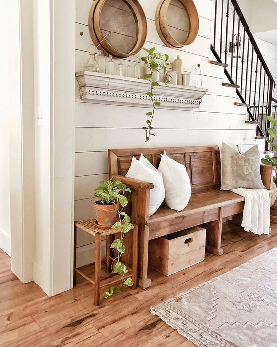 entryway, wooden floor, wooden bench, wooden wide table, floating shelves, round decoration