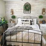 Farmhouse Bedroom, Brown Rug, Cream Wooden Plank, Ceiling Fan And Lam, White Wooden Side Cabinet, Cream Wall, Black Metal Bed Platform