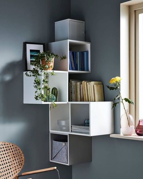 floating corner squares boxes in white, grey wall, window, rattan chair