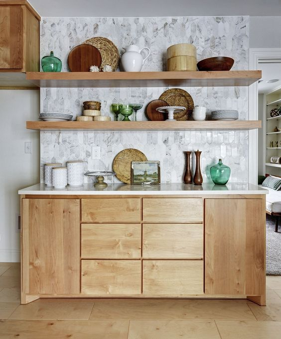 floating shelves, grey accent wall, wooden cabinet with white counter top