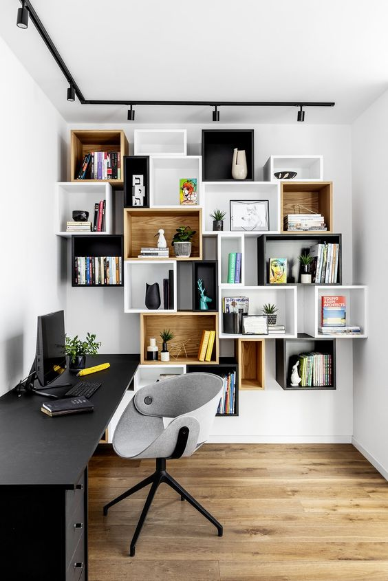floating white black boxes shelves, wooden floor, white wall, black table, grey chair