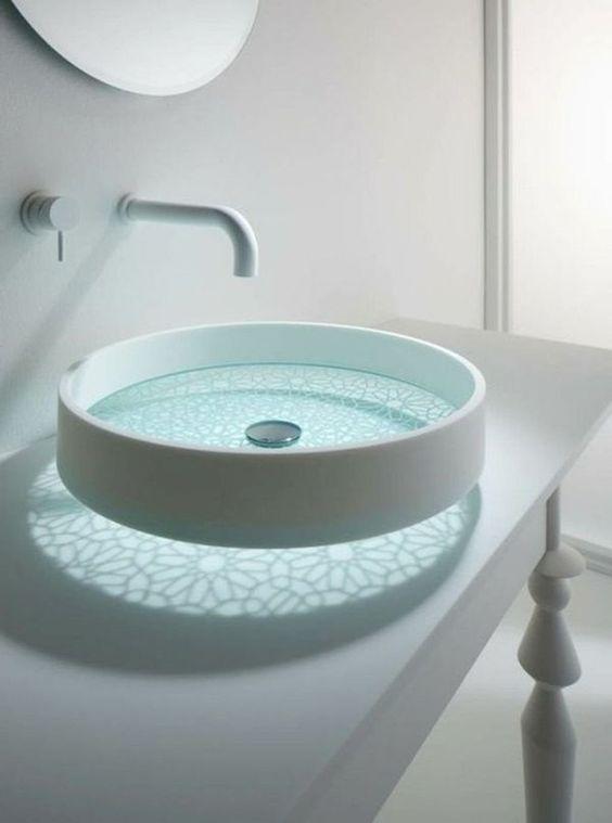 glass sink with flower pattern, white round frame, white faucet, white vanity, round mirror