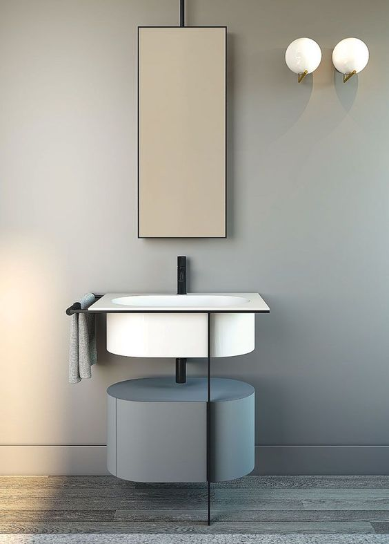 grey wall, white sink, grey cabinet, tall mirror, white sconces
