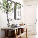 Hallway, Brown Floor Tiles, White Wall, White Wooden Floor, Grey Table With Cross Legs