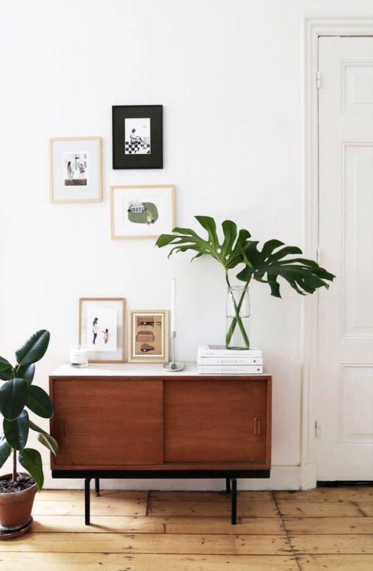 hallway, wooden floor, wooden cabinet with sliding door, white wall, white door