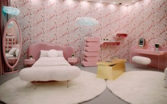 kids room, grey floor, white roudn rug, pink headboard, white bed, pink flamingo wallpaper, pink stack boxes, pink mirror, pink table