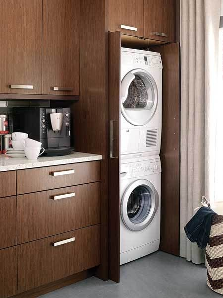 kitchen, concrete floor, wooden cabinet, wooden cupboard, laundry machines. white counter top