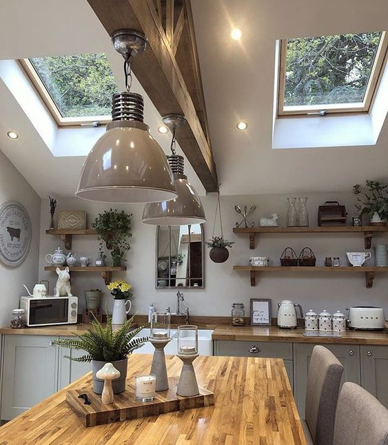 kitchen, cream bottom cabinet, white wall, floating wooden shelves, wooden table, cream chairs, grey pendants, wooden beam, glass ceiling window