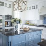 Kitchen, Dark Marble Floor, White Cabinet, Blue Cabinet, White Subway Tiles, Golden Pendantm Black Marble Counter Top