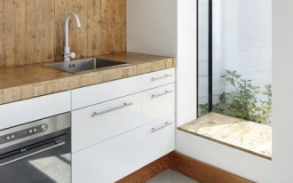 kitchen, grey floor, white wall, white cabinet, wooden counter top, wooden backsplash