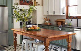 kitchen, white black patterned floor, white wall, black pendants, wooden table, white stool, mint green cabinet, white upper cabinet