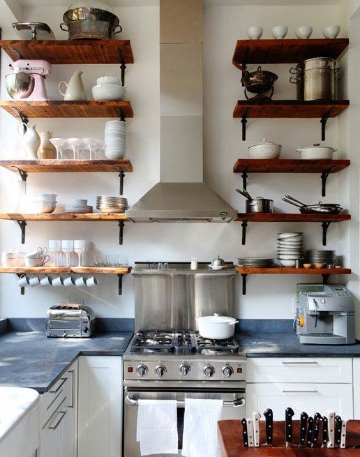 kitchen, white cabinet with grey counter top, white wall, floating shelves,