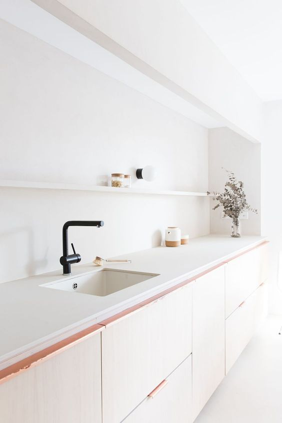 kitchen, white indented wall, white counter top, light brown cabinet, white floor