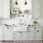 Kitchen, White Red Patterned Floor, White Wall, White Cabinet, White Marble Counter Top, White Square Backsplash, White Apron Sink, Black Sconces