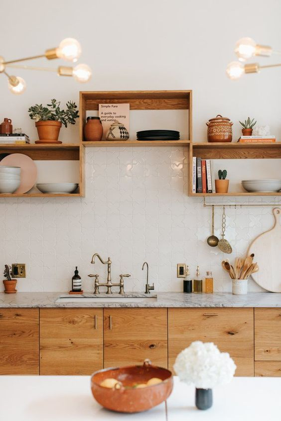 kitchen, white square wall tiles, wooden bottom cabinet, wooden uneven upper shelves, grey marble top, white island