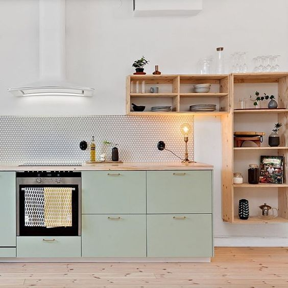 kitchen, white wall, tiny tiles backsplash, mint green cabinet with wooden top, wooden shelves, wooden floor