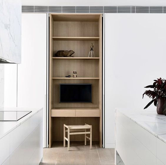 kitchen, woden floor, white cupboard, white island, white counter top, wooden shelves with floating table, wooden stool