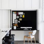 Kitchen, Wooden Floor, White Cabinet, White Floating Box Table And Wall, White Island, Black Stools